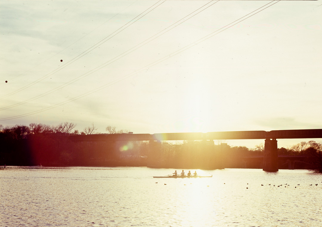 Rowers rowing down the lake